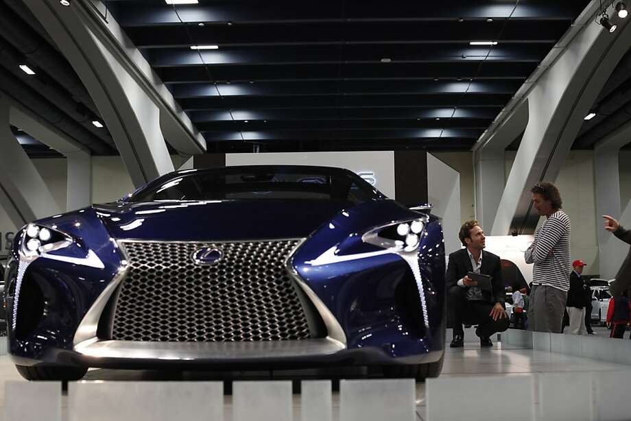 Lexus product specialist Danny Bopp answers questions about the LF-LC hybrid sport coupe from Mike Shoemaker, right, of San Diego, at opening day at the 55th San Francisco International Auto Show in San Francisco, Calif., Thursday, November 22, 2012. Photo: Sarah Rice, Special To The Chronicle