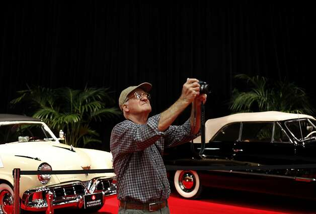 Hugh Pinney, of Santa Clara, takes a photo of the classic cars at the Academy of Art University exhibit at opening day of the 55th San Francisco International Auto Show in San Francisco, Calif., Thursday, November 22, 2012. Photo: Sarah Rice, Special To The Chronicle