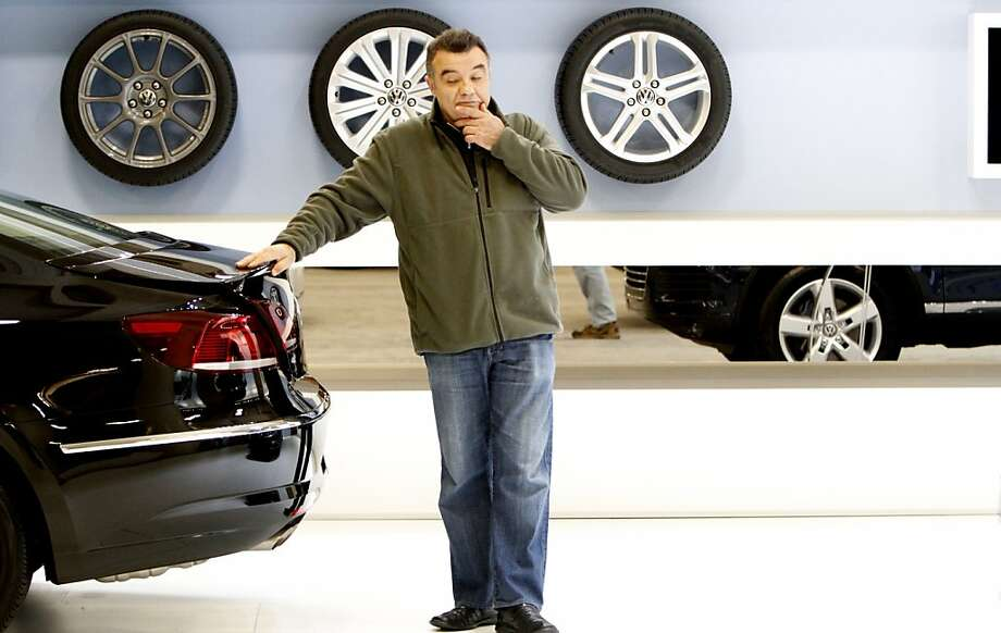 Boris Bentchev, of Danville, pauses for a moment to think while checking out the trunk of the Volkswagen CC Sport Plus at opening day of the 55th San Francisco International Auto Show in San Francisco, Calif., Thursday, November 22, 2012. Photo: Sarah Rice, Special To The Chronicle