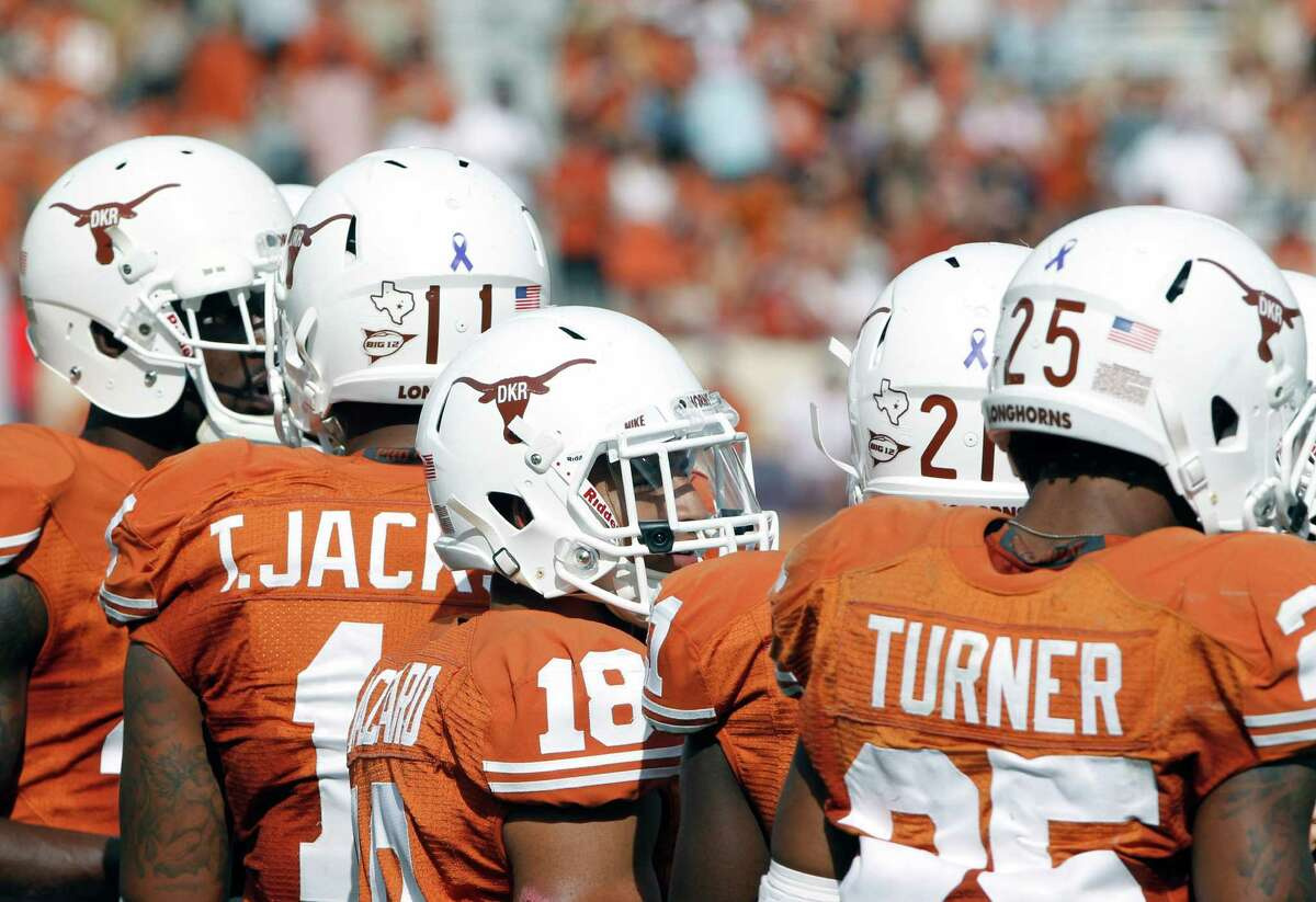 Texas players wear a Texas Longhorn helmet logo with the initials of former head coach Darrell K Royal in an NCAA college football game against Iowa State at Darrell K Royal-Memorial Stadium, Saturday, Nov. 10, 2012, in Austin, Texas. Texas won 33-7. (AP Photo/Michael Thomas)