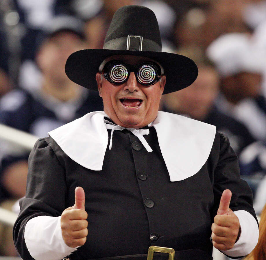 A Dallas Cowboys fan wears a pilgrim costume during the game with the Washington Redskins Thursday Nov. 22, 2012 at Cowboys Stadium in Arlington, Tx.  The Redskins won 38-31. Photo: Edward A. Ornelas, Express-News / © 2012 San Antonio Express-News