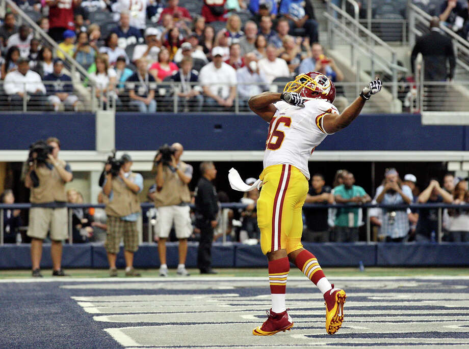 Washington Redskins' Alfred Morris celebrates after scoring a touchdown against the Dallas Cowboys during first half action Thursday Nov. 22, 2012 at Cowboys Stadium in Arlington, Tx. Photo: Edward A. Ornelas, Express-News / © 2012 San Antonio Express-News