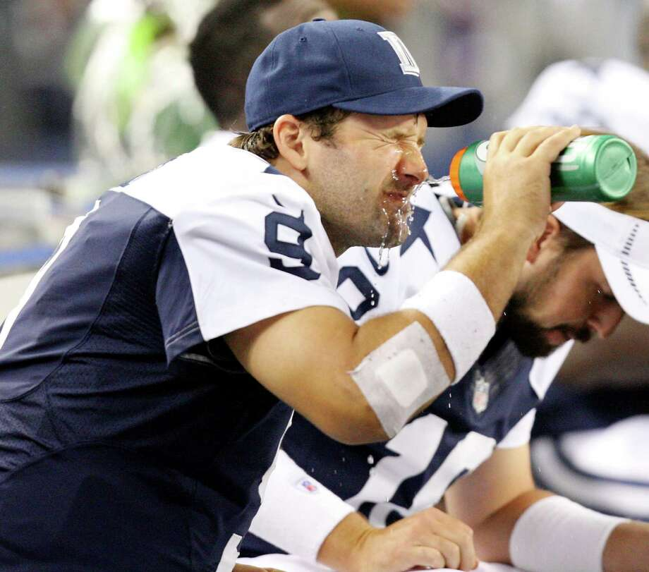Dallas Cowboys' Tony Romo squirts water on his face while on the bench  during second half action against the Washington Redskins Thursday Nov. 22, 2012 at Cowboys Stadium in Arlington, Tx.  The Redskins won 38-31. Photo: Edward A. Ornelas, Express-News / © 2012 San Antonio Express-News