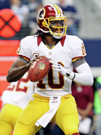Washington Redskins' Robert Griffin III looks to pass against the Dallas Cowboys during first half action Thursday Nov. 22, 2012 at Cowboys Stadium in Arlington, Tx. Photo: Edward A. Ornelas, Express-News / © 2012 San Antonio Express-News