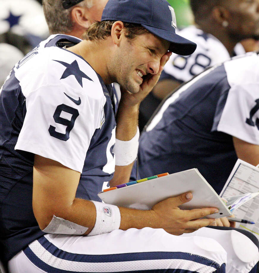 Dallas Cowboys' Tony Romo sits on the bench after being sacked during second half action against the Washington Redskins Thursday Nov. 22, 2012 at Cowboys Stadium in Arlington, Tx.  The Redskins won 38-31. Photo: Edward A. Ornelas, Express-News / © 2012 San Antonio Express-News