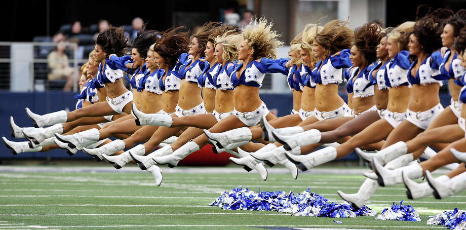 Members of the Dallas Cowboys Cheerleaders perform before the game with the Washington Redskins Thursday Nov. 22, 2012 at Cowboys Stadium in Arlington, Tx. Photo: Edward A. Ornelas, Express-News / © 2012 San Antonio Express-News