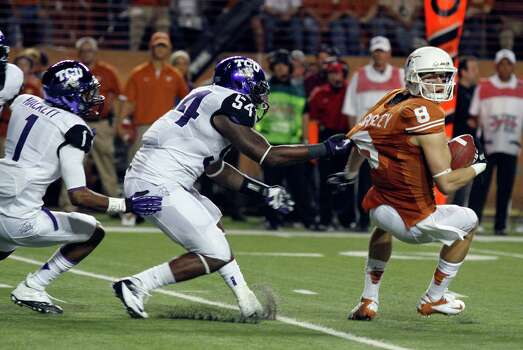 TCU's Marcus Mallet (54) and Chris Hackett (1) pressure Texas receiver Jaxon Shipley (8) during the first half of an NCAA college football game on Thursday, Nov. 22, 2012, in Austin, Texas. (AP Photo/Jack Plunkett) Photo: Jack Plunkett, Associated Press / FR59553 AP