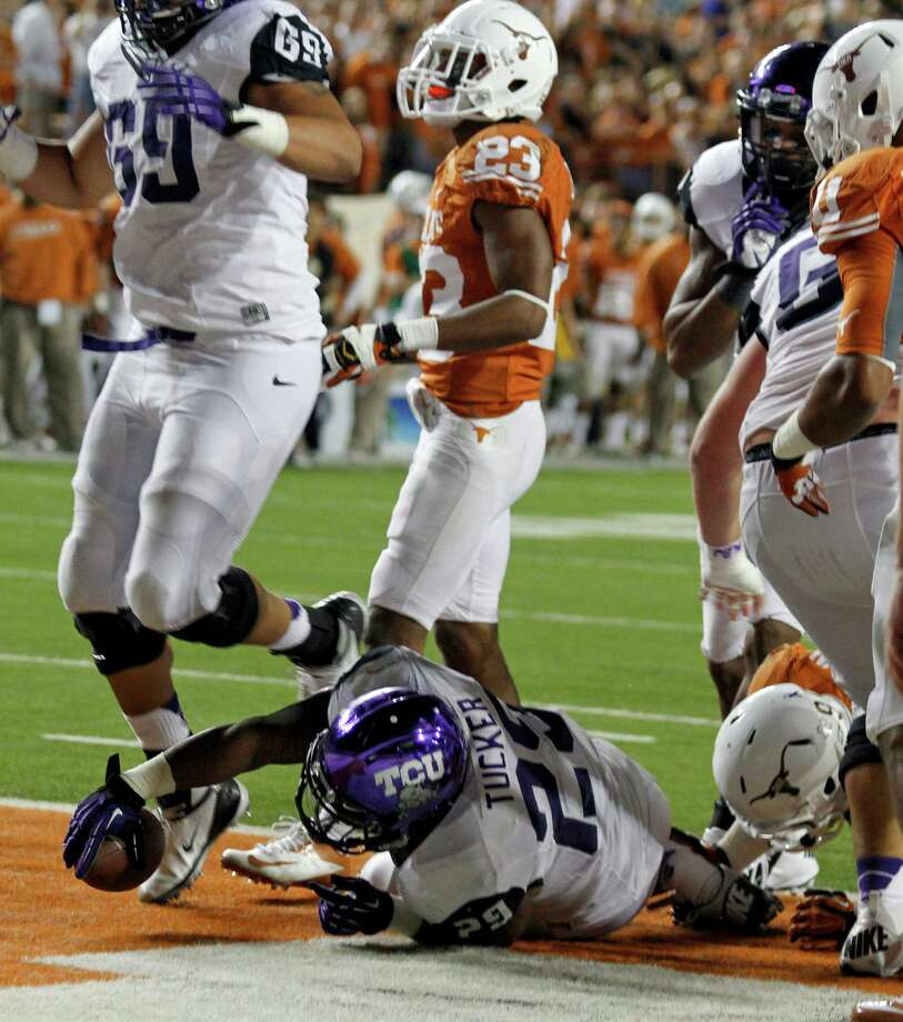 TCU's Matthew Tucker (29) crosses the goal line to score against Texas during the first half of an NCAA college football game on Thursday, Nov. 22, 2012, in Austin, Texas.(AP Photo/Jack Plunkett) Photo: Jack Plunkett, Associated Press / FR59553 AP