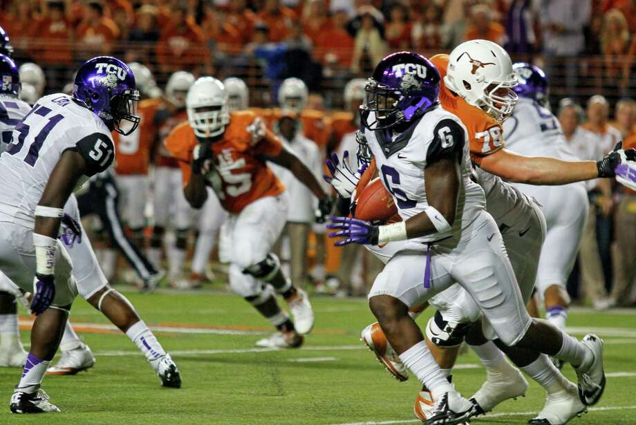 TCU safety Elisha Olabode (6) runs after intercepting a Texas pass during the first half of an NCAA college football game on Thursday, Nov. 22, 2012, in Austin, Texas. (AP Photo/Jack Plunkett) Photo: Jack Plunkett, Associated Press / FR59553 AP