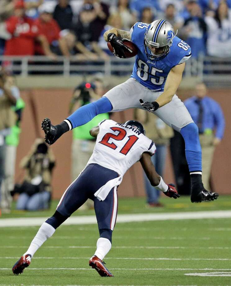 Detroit Lions tight end Tony Scheffler (85) jumps over Houston Texans defensive back Brice McCain (21) during overtime of an NFL football game at Ford Field in Detroit, Thursday, Nov. 22, 2012. (AP Photo/Paul Sancya) Photo: Paul Sancya