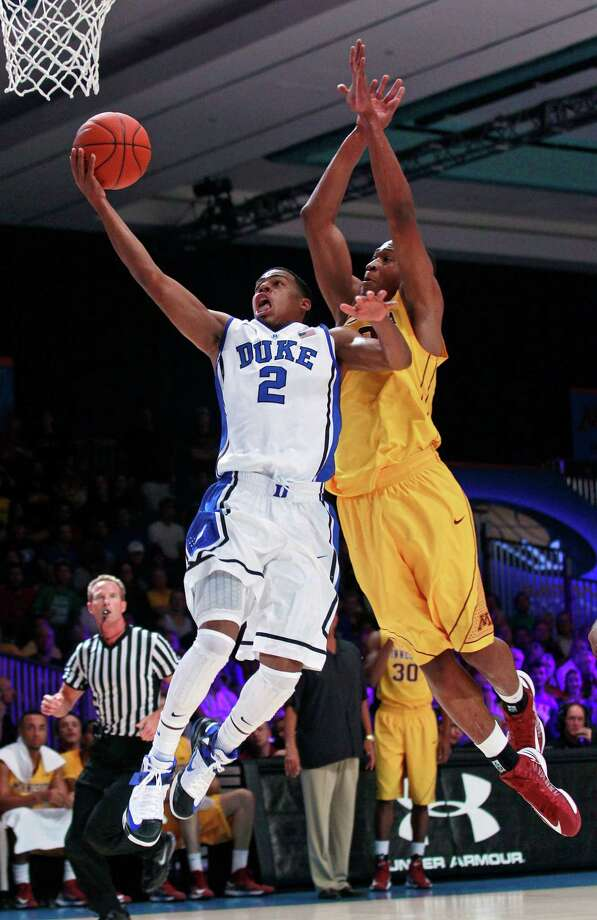 Duke guard Quinn Cook (2) drives to the basket as Minnesota forward Rodney Williams Jr. (33) defends during the first half of an NCAA college basketball game at the Battle 4 Atlantis tournament, Thursday, Nov. 22, 2012, in Paradise Island, Bahamas. (AP Photo/John Bazemore) Photo: John Bazemore