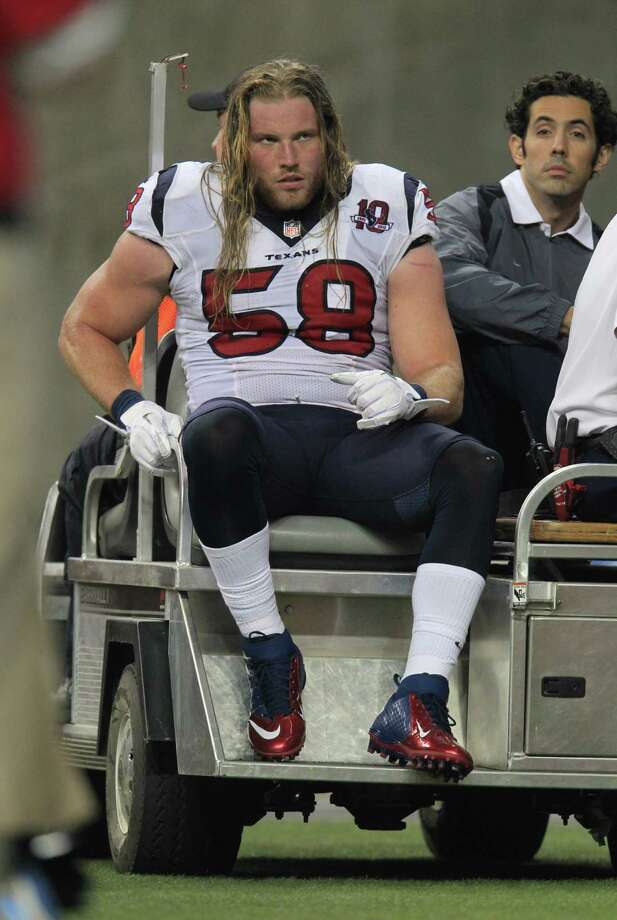 Texans linebacker Brooks Reed is driven back to the locker room after straining his left groin during the first quarter Thursday in Detroit. Reed is scheduled to have an MRI on Friday. Photo: Karen Warren, Staff / © 2012  Houston Chronicle