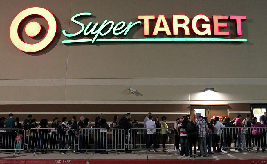 At least 1,000 shoppers wait in line at Super Target at Wonderland of the Americas on Thursday, Nov. 22, 2012. Target opened at 9 p.m. on Thanksgiving Day for shoppers looking for sales ahead of Black Friday. Photo: Kin Man Hui, San Antonio Express-News / ©2012 San Antonio Express-News