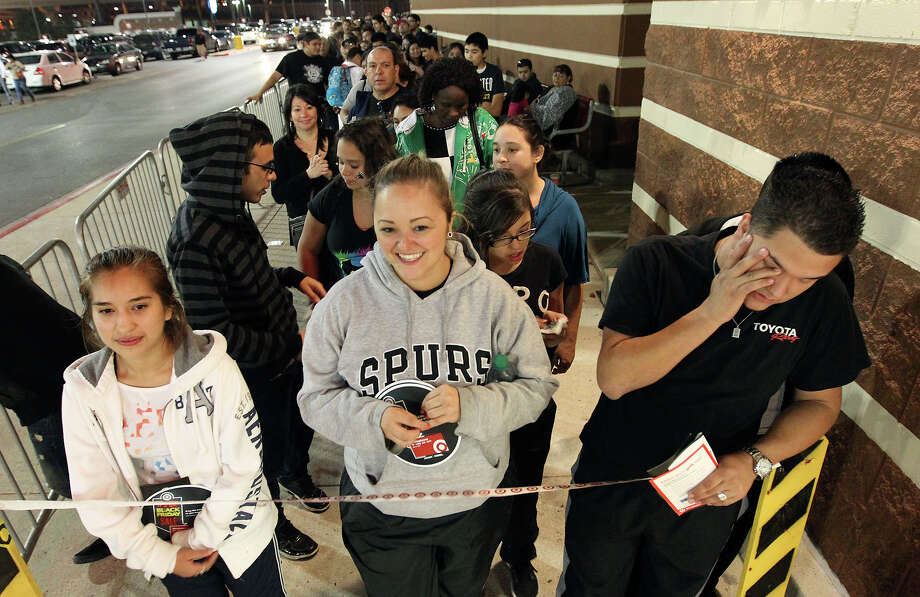 Cousins Ashley Martinez (from left), Crystal Lozano and Zac Leard wait out the last remaining moments after being in line since 8 a.m. to be the first shoppers at Super Target at Wonderland of the Americas. Target opened at 9 p.m. on Thanksgiving Day. Photo: Kin Man Hui, San Antonio Express-News / ©2012 San Antonio Express-News