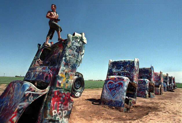 Roberto Pizzetti takes in the sight of the Cadillac Ranch in Amarillo, along Route 66. Photo: RANDY ELI GROTHE, KRT / DALLAS MORNING NEWS