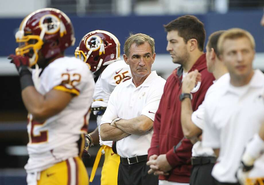 Washington Redskins head coach Mike Shanahan, center,  before the first half of an NFL football game against the Dallas Cowboys Thursday, Nov. 22, 2012 in Arlington, Texas. (AP Photo/Tim Sharp) Photo: Tim Sharp, Associated Press