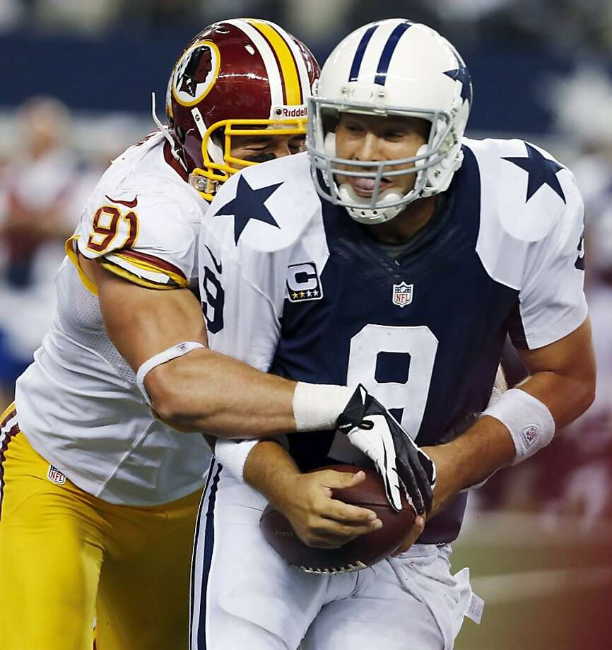 Dallas Cowboys quarterback Tony Romo (9) is sacked by Washington Redskins outside linebacker Ryan Kerrigan (91) during the second half of an NFL football game, Thursday, Nov. 22, 2012, in Arlington, Texas. The Redskins won 38-31. (AP Photo/The Waco Tribune-Herald, Jose Yau) Photo: Jose Yau, Associated Press