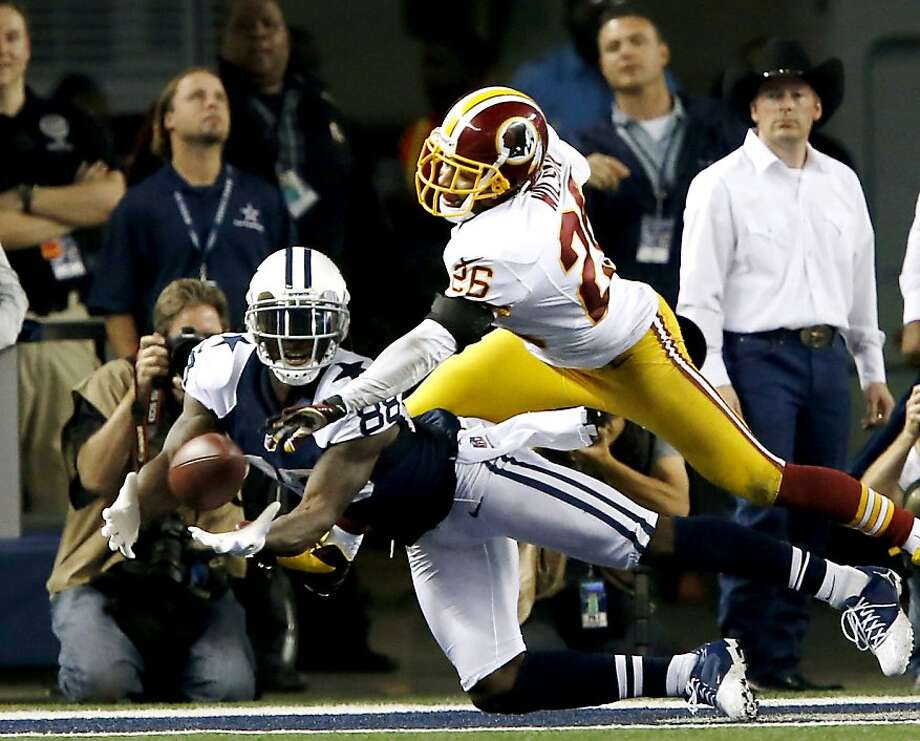 Dallas Cowboys running back Felix Jones (28) pulls in a touchdown under pressure from Washington Redskins cornerback Josh Wilson (26) during the second half of an NFL football game, Thursday, Nov. 22, 2012, in Arlington, Texas. The Redskins won 38-31. (AP Photo/The Waco Tribune-Herald, Jose Yau) Photo: Jose Yau, Associated Press