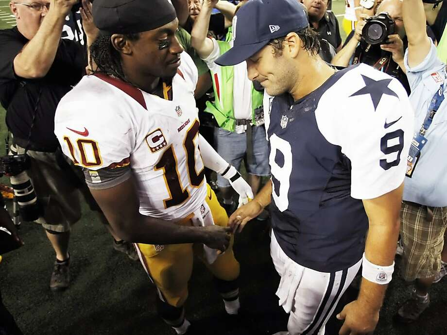 Washington Redskins quarterback Robert Griffin III (10) and Dallas Cowboys quarterback Tony Romo (9) shake hands following the Redskins' 38-31 victory over the Cowboys at Cowboys Stadium in Arlington, Texas, Thursday, November 22, 2012. (Brandon Wade/Fort Worth Star-Telegram/MCT) Photo: Brandon Wade, McClatchy-Tribune News Service