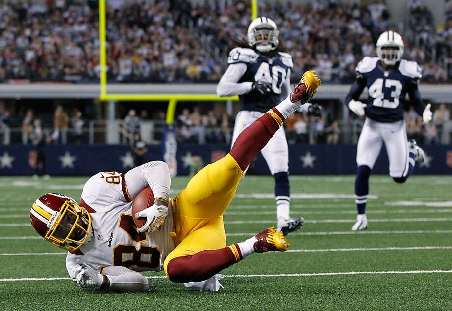 ARLINGTON, TX - NOVEMBER 22:  Niles Paul #84 of the Washington Redskins scores a touchdown against the Dallas Cowboys on Thanksgiving Day at Cowboys Stadium on November 22, 2012 in Arlington, Texas. The Washington Redskins beat the Dallas Cowboys 38-31.  (Photo by Tom Pennington/Getty Images) Photo: Tom Pennington, Getty Images