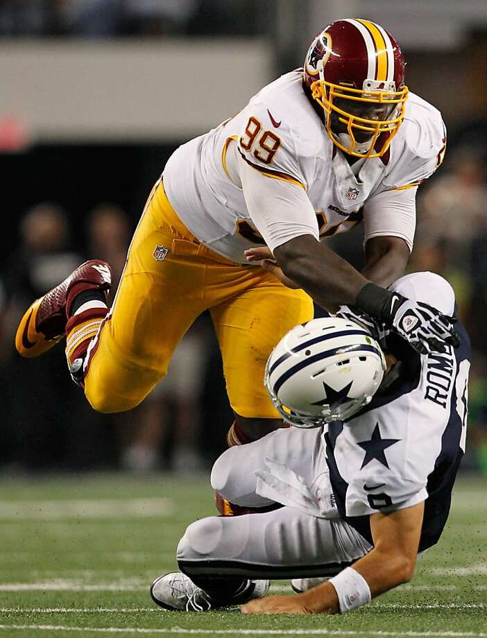 ARLINGTON, TX - NOVEMBER 22:  Jarvis Jenkins #99 of the Washington Redskins knocks Tony Romo #9 of the Dallas Cowboys to the turf on Thanksgiving Day at Cowboys Stadium on November 22, 2012 in Arlington, Texas. The Washington Redskins beat the Dallas Cowboys 38-31. (Photo by Tom Pennington/Getty Images) Photo: Tom Pennington, Getty Images