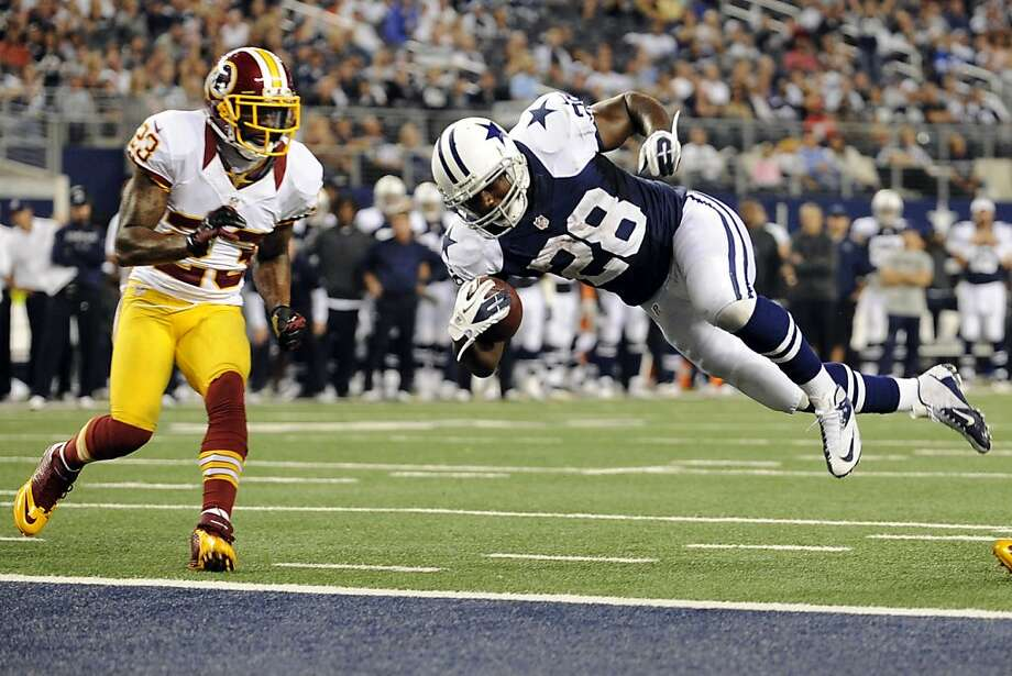 Dallas Cowboys' Felix Jones (28) dives into the end zone for a touchdown as Washington Redskins cornerback DeAngelo Hall (23) watches in the second half of an NFL football game, Thursday, Nov. 22, 2012, in Arlington, Texas. (AP Photo/Matt Strasen) Photo: Matt Strasen, Associated Press