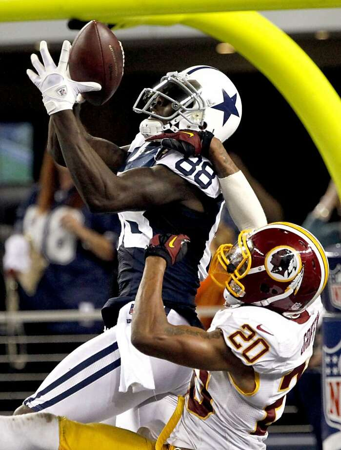 Washington Redskins defensive back Cedric Griffin (20) breaks up a pass in the end zone intended for Dallas Cowboys' Dez Bryant (88) late in the second half of an NFL football game, Thursday, Nov. 22, 2012, in Arlington, Texas. The Redskins won 38-31. (AP Photo/Tim Sharp) Photo: Tim Sharp, Associated Press