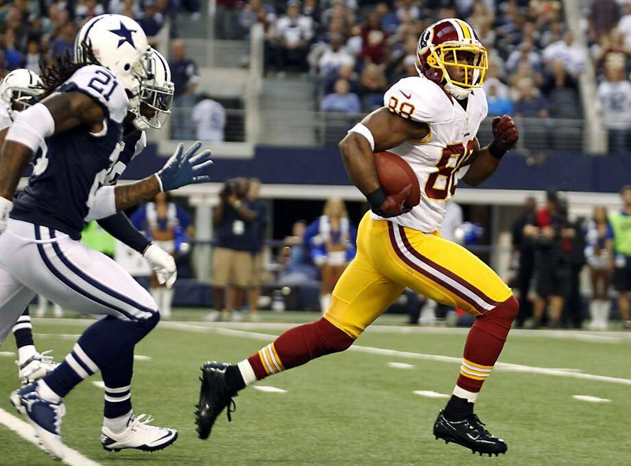 Washington Redskins wide receiver Pierre Garcon (88) looks back at Dallas Cowboys' Mike Jenkins (21) as he sprints for the end zone for a touchdown in the first half of an NFL football game, Thursday, Nov. 22, 2012, in Arlington, Texas. (AP Photo/Tim Sharp) Photo: Tim Sharp, Associated Press