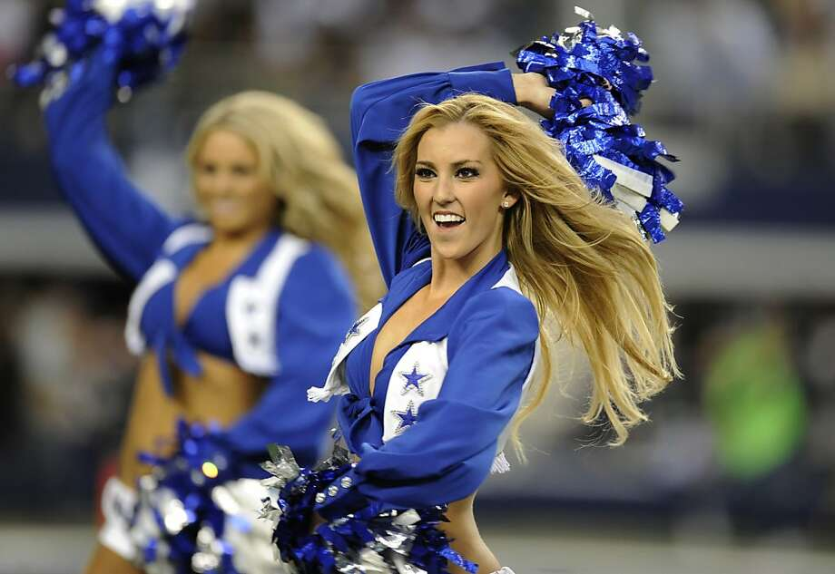 Dallas Cowboys cheerleaders perform during the second half of an NFL football game against the Washington Redskins Thursday, Nov. 22, 2012 in Arlington, Texas.  (AP Photo/Matt Strasen) Photo: Matt Strasen, Associated Press