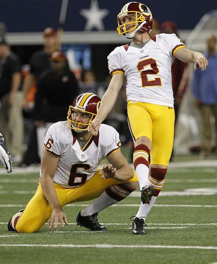 Washington Redskins punter Sav Rocca (6) and kicker Kai Forbath (2) watch a field goal by Forbath go through the uprights late in the second half of an NFL football game against the Dallas Cowboys Thursday, Nov. 22, 2012 in Arlington, Texas. (AP Photo/Tim Sharp) Photo: Tim Sharp, Associated Press
