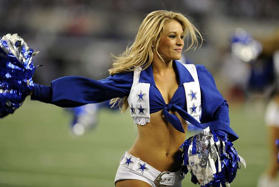 A Dallas Cowboys cheerleader performs during the second half of an NFL football game against the Washington Redskins Thursday, Nov. 22, 2012 in Arlington, Texas.  (AP Photo/Matt Strasen) Photo: Matt Strasen, Associated Press
