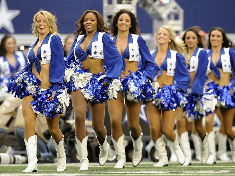 Dallas Cowboys cheerleaders perform during a break against the Washington Redskins during the first half of an NFL football game Thursday, Nov. 22, 2012 in Arlington, Texas. (AP Photo/Matt Strasen) Photo: Matt Strasen, Associated Press