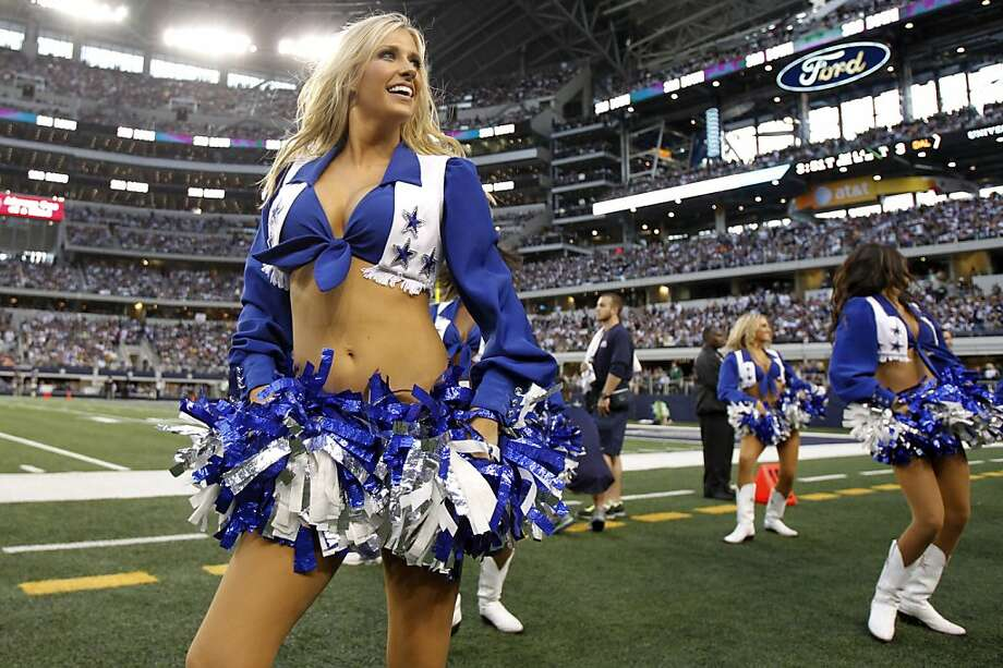Dallas Cowboys cheerleaders perform during the second half of an NFL football game against the Washington Redskins Thursday, Nov. 22, 2012 in Arlington, Texas. (AP Photo/Tim Sharp) Photo: Tim Sharp, Associated Press