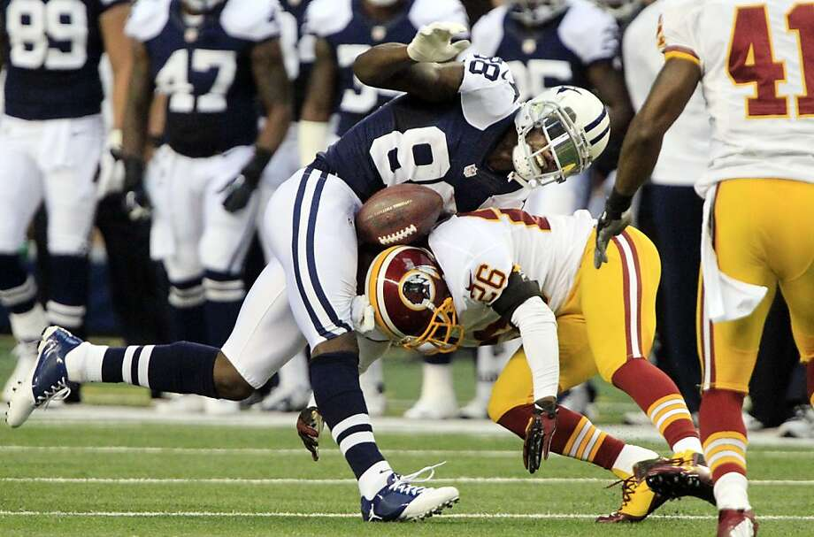 Washington Redskins cornerback Josh Wilson (26) puts his helmet on the football causing a fumble by Dallas Cowboys wide receiver Dez Bryant (88) in the second quarter at Texas Stadium in Arlington, Texas, Thursday, November 22, 2012 . The Redskins recovered the ball and scored soon after. (John Rhodes/Fort Worth Star-Telegram/MCT) Photo: John Rhodes, McClatchy-Tribune News Service
