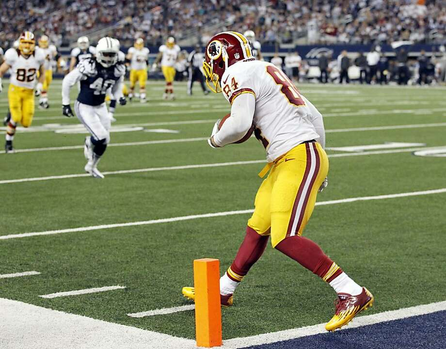 Washington Redskins tight end Niles Paul (84) falls all alone after catching a pass near the Redskins end zone against the Dallas Cowboys in the fourth quarter. Since he was untouched, he rolled over and continued in for the score. The Redskins defeated the Cowboys, 38-31, at Cowboys Stadium in Arlington, Texas, Thursday, November 22, 2012. (John Rhodes/Fort Worth Star-Telegram/MCT) Photo: John Rhodes, McClatchy-Tribune News Service