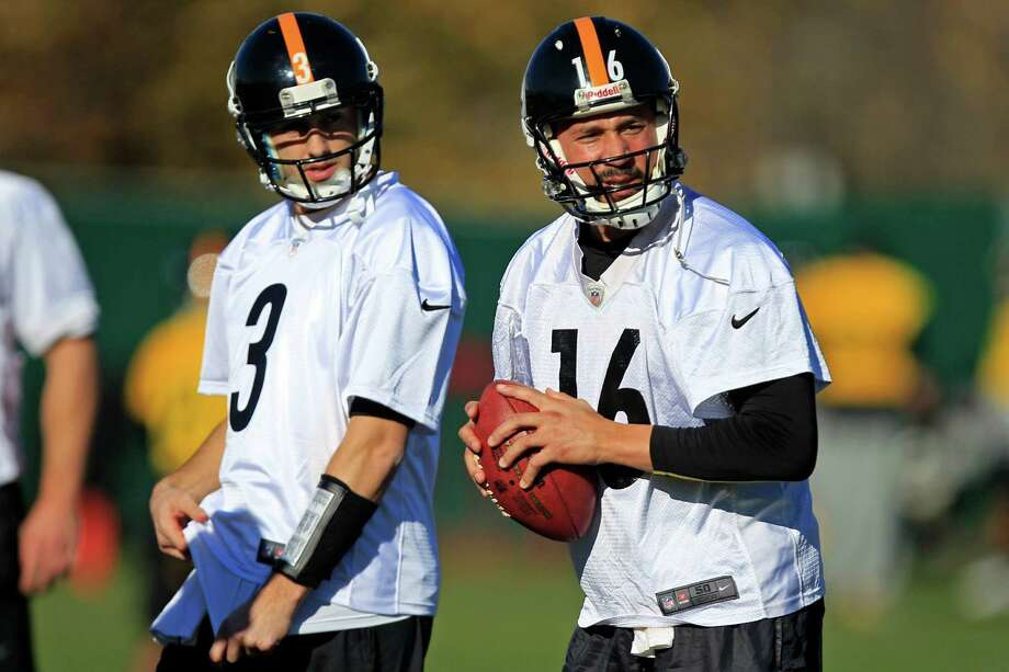 Pittsburgh Steelers quarterbacks Charlie Batch (16) and newly signed Brian Hoyer (3) warm up during NFL football practice, Wednesday, Nov. 21, 2012, in Pittsburgh. (AP Photo/Gene J. Puskar) Photo: Gene J. Puskar
