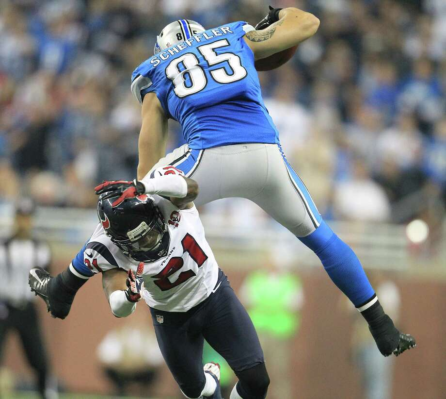 Lions tight end Tony Scheffler (85) went airborne over Brice McCain (21) to extend what ended up being just one of many big passing plays by Detroit. Photo: Karen Warren, Staff / © 2012  Houston Chronicle