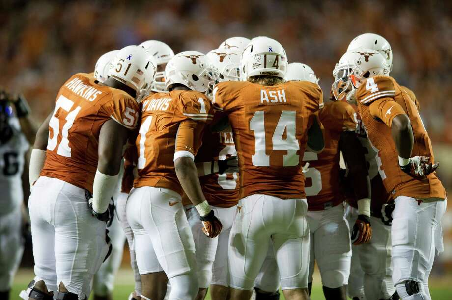 AUSTIN, TX - NOVEMBER 22:  David Ash #14 of the Texas Longhorns leads the huddle against the TCU Horned Frogs on November 22, 2012 at Darrell K Royal-Texas Memorial Stadium in Austin, Texas. Photo: Cooper Neill, Getty Images / 2012 Getty Images