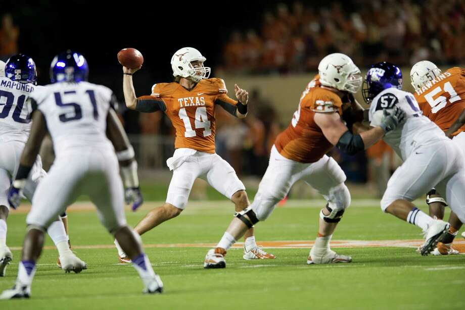 AUSTIN, TX - NOVEMBER 22:  David Ash #14 of the Texas Longhorns throws a pass against the TCU Horned Frogs on November 22, 2012 at Darrell K Royal-Texas Memorial Stadium in Austin, Texas. Photo: Cooper Neill, Getty Images / 2012 Getty Images