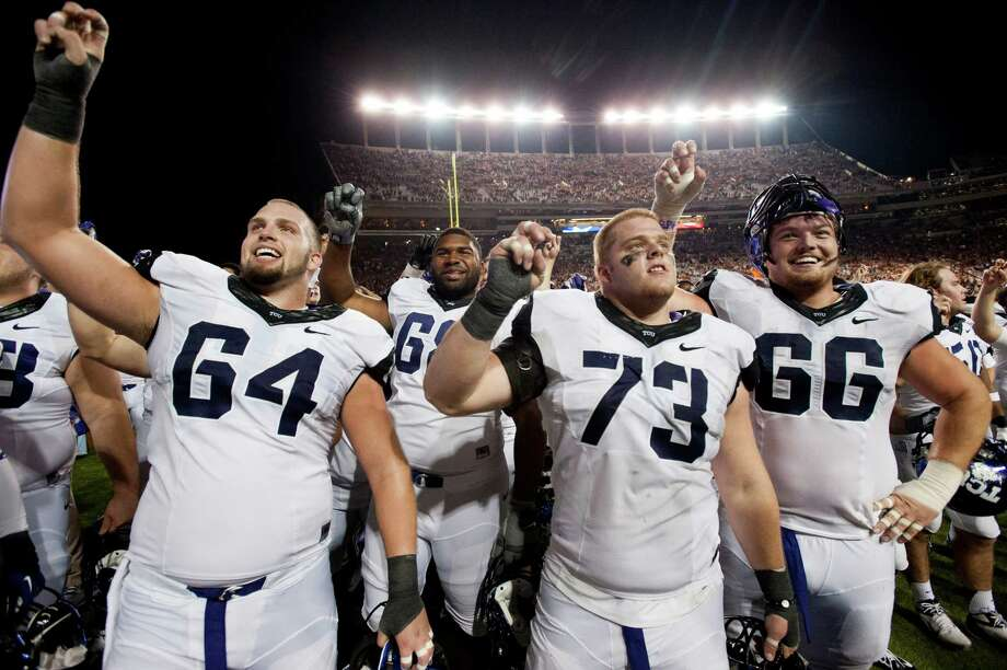 AUSTIN, TX - NOVEMBER 22:  James Fry #64 of the TCU Horned Frogs celebrates with teammates Eric Tausch #73 and Blaize Foltz #66 after defeating the Texas Longhorns on November 22, 2012 at Darrell K Royal-Texas Memorial Stadium in Austin, Texas. Photo: Cooper Neill, Getty Images / 2012 Getty Images