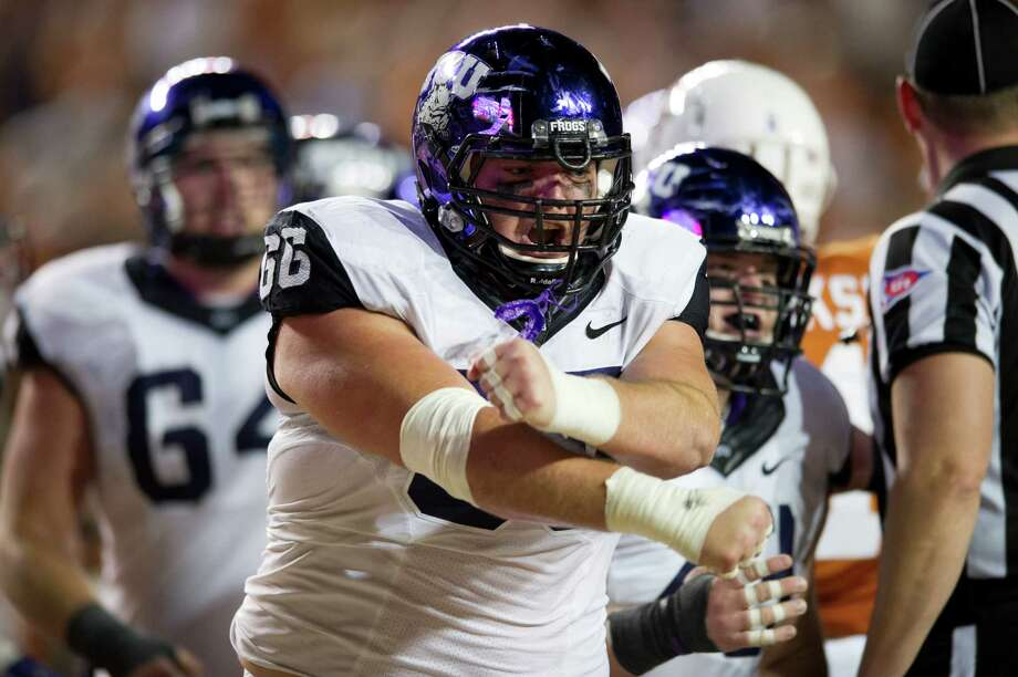 AUSTIN, TX - NOVEMBER 22:  Blaize Foltz #66 of the TCU Horned Frogs celebrates after a touchdown against the Texas Longhorns on November 22, 2012 at Darrell K Royal-Texas Memorial Stadium in Austin, Texas. Photo: Cooper Neill, Getty Images / 2012 Getty Images