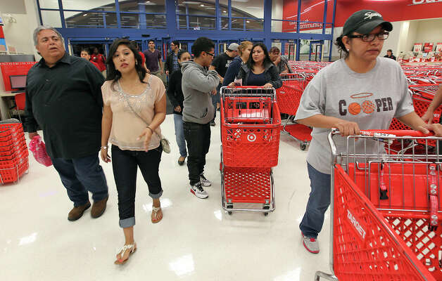 Shoppers stream into Super Target at Wonderland of the Americas on Thursday, Nov. 22, 2012. Target opened at 9 p.m. on Thanksgiving Day for shoppers looking for sales ahead of Black Friday. Photo: Kin Man Hui, San Antonio Express-News / ©2012 San Antonio Express-News