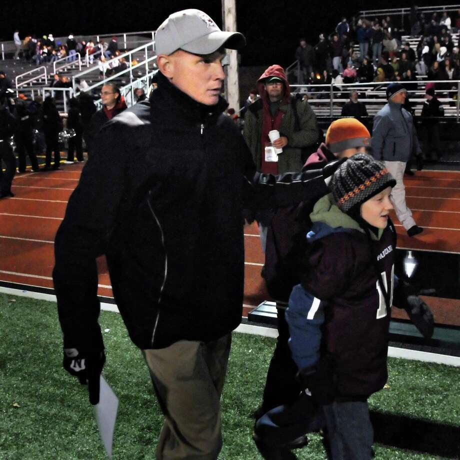Burnt Hills head coach Matt Shell and son Jacob Shell, 9, arrive on the field for theClass A Super Bowl game against Lansingburgh at Shenendehowa High in Clifton Park Saturday night November 6, 2010.   (John Carl D'Annibale / Times Union) Photo: John Carl D'Annibale / 00010887A