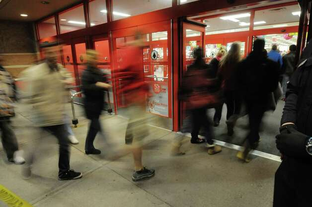 Shoppers make their way in as the doors open at the Target store on Thursday evening, Nov. 22, 2012 in Colonie, NY.  The store opened at 9pm on Thursday evening, giving shoppers an early start on black friday shopping.  (Paul Buckowski / Times Union) Photo: Paul Buckowski