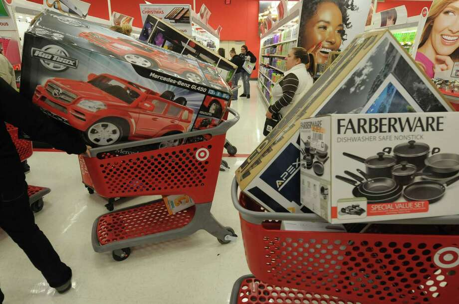 Shoppers with carts filled make their way through the Target store on Thursday evening, Nov. 22, 2012 in Colonie, NY.  The store opened at 9pm on Thursday evening, giving shoppers an early start on black friday shopping.  (Paul Buckowski / Times Union) Photo: Paul Buckowski