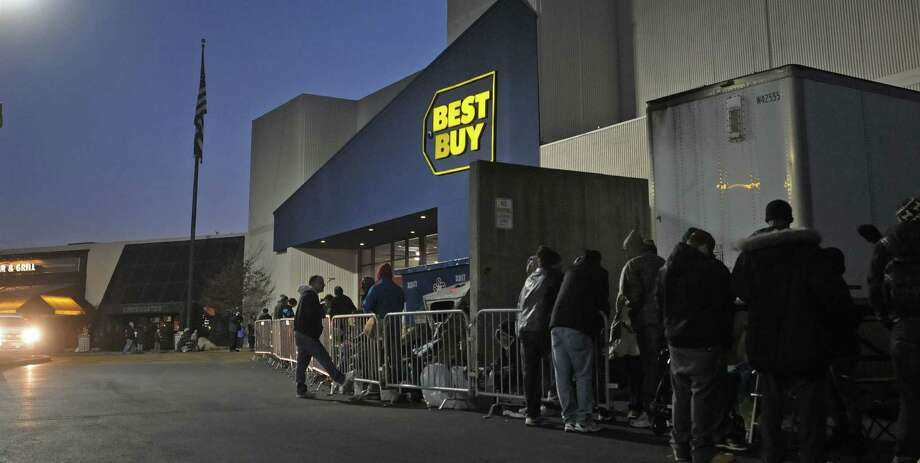 Shoppers stand in line outside the Best Buy at Crossgates Mall on Thursday evening, Nov. 22, 2012 in Albany, NY.  The store was opening up at midnight.   (Paul Buckowski / Times Union) Photo: Paul Buckowski  / 00020212A