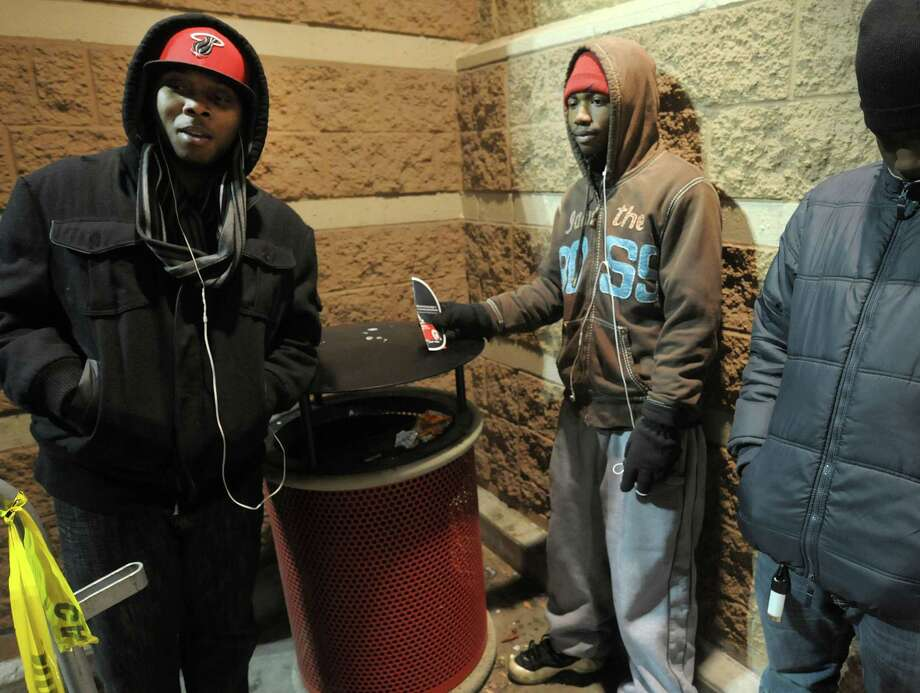 Kwame Lewis, left, and Kwamel Bryant are at the front of the line outside the Target store on Thursday evening, Nov. 22, 2012 in Colonie, NY.  The store opened at 9pm on Thursday evening, giving shoppers an early start on black friday shopping.  (Paul Buckowski / Times Union) Photo: Paul Buckowski  / 00020212A