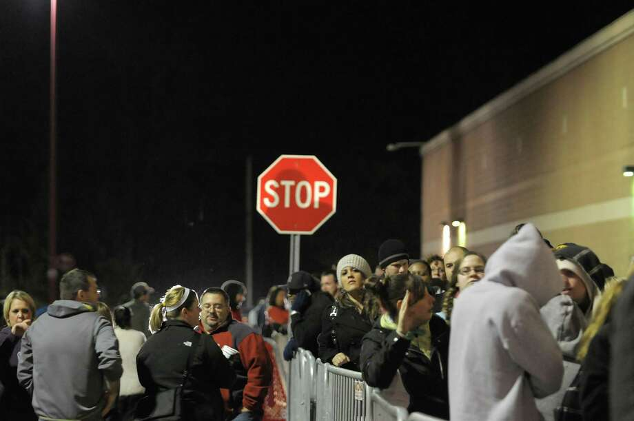 Shoppers wait in line outside the Target store on Thursday evening, Nov. 22, 2012 in Colonie, NY.  The store opened at 9pm on Thursday evening, giving shoppers an early start on black friday shopping.  (Paul Buckowski / Times Union) Photo: Paul Buckowski
