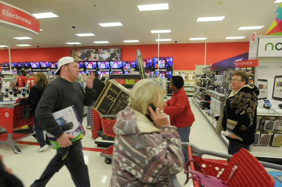 Shoppers scurry about the electronics department at the Target store on Thursday evening, Nov. 22, 2012 in Colonie, NY.  The store opened at 9pm on Thursday evening, giving shoppers an early start on black friday shopping.  (Paul Buckowski / Times Union) Photo: Paul Buckowski  / 00020212A