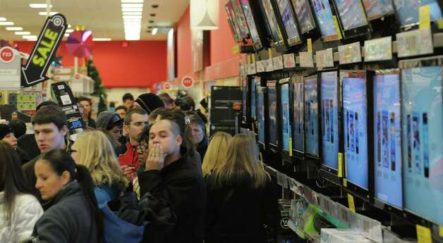 Shoppers wait in line to pay for their purchases  at the Target store on Thursday evening, Nov. 22, 2012 in Colonie, NY.  The store opened at 9pm on Thursday evening, giving shoppers an early start on black friday shopping.  (Paul Buckowski / Times Union) Photo: Paul Buckowski